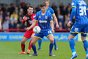 Connor Smith defender for AFC Wimbledon (18) protects the ball during the Sky Bet League 2 match between AFC Wimbledon and Crawley Town at the Cherry Red Records Stadium, Kingston, England on 16 April 2016. Photo by Stuart Butcher.