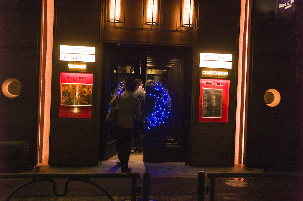 The Blue Note  outside Lee Rintenour show Group of fans photographing poster  for  tonights show.