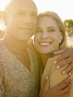 Senior couple embracing at sunset close up