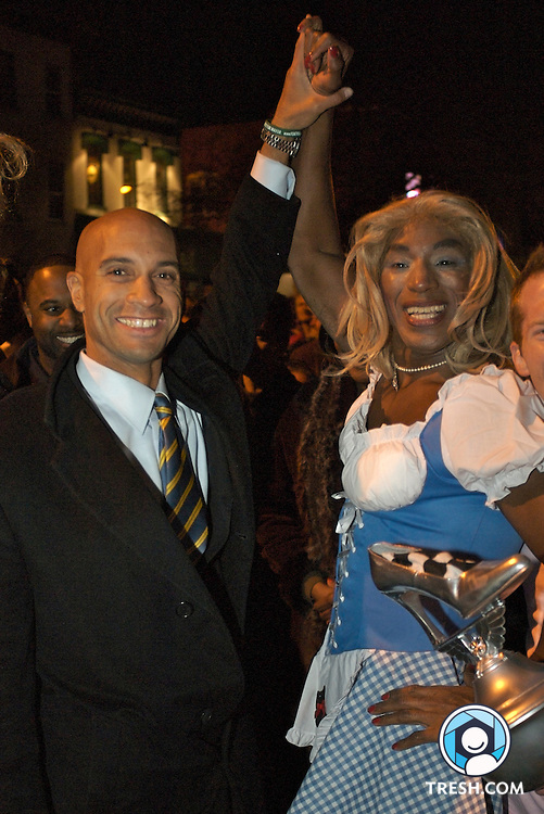 Democratic mayoral nominee Adrian M. Fenty, left, congratulates Ron Brown of Washington, D.C. Brown won the 20th annual High Heel Race Tuesday night, October 24, 2006, held at 17th and Q streets, NW.