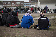 Migrants waiting for the soup kitchen van in Calais