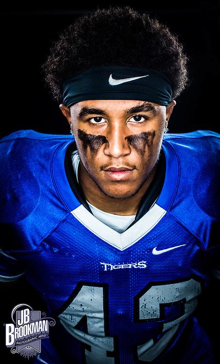 Franklin Senior Portraits football player in blue uniform with Nike headband
