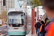 27 DECEMBER 2008 -- PHOENIX, AZ: At 10:17AM A train arrives at a station in Phoenix on Central Ave. Metro Light Rail started running Saturday, Dec. 28.  The light rail line is 20 miles long and cost $1.4 billion dollars. PHOTO BY JACK KURTZ