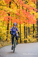 Sally Marchand Collins road bicycling in autumn at Brown County State Park, Indiana, USA model released