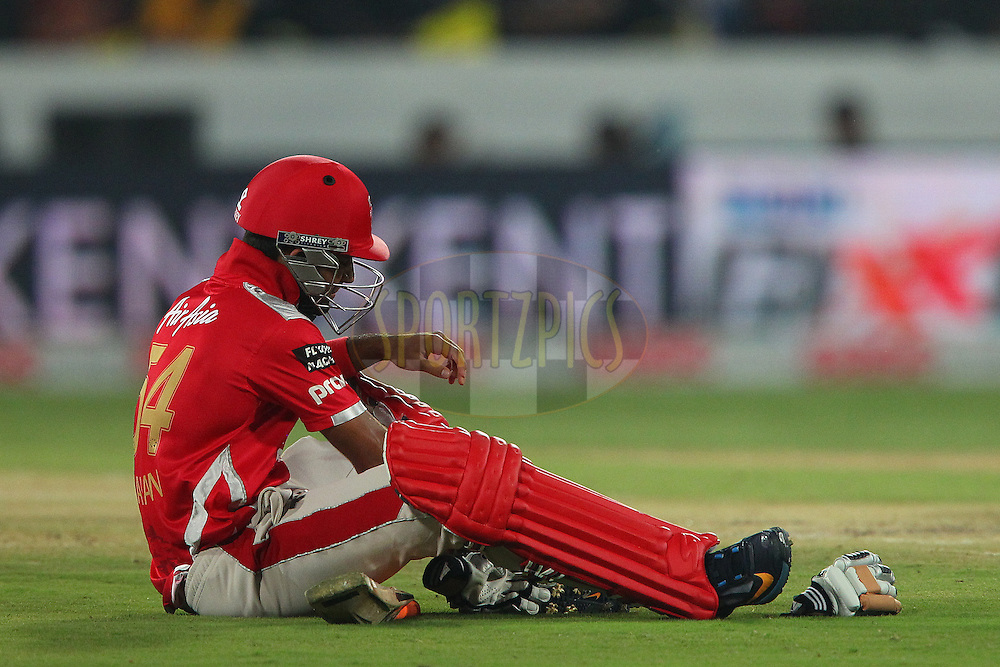 Manan VOHRA of the Kings XI Punjab sits on the floor after he was hit on the ankle by a delivery during the second semi final match of the Oppo Champions League Twenty20 between the Kings XI Punjab and the Chennai Superkings held at the Rajiv Gandhi Cricket Stadium, Hyderabad, India on the 2nd October 2014<br /> <br /> Photo by:  Ron Gaunt / Sportzpics/ CLT20<br /> <br /> <br /> Image use is subject to the terms and conditions as laid out by the BCCI/ CLT20.  The terms and conditions can be downloaded here:<br /> <br /> http://sportzpics.photoshelter.com/gallery/CLT20-Image-Terms-and-Conditions-2014/G0000IfNJn535VPU/C0000QhhKadWcjYs