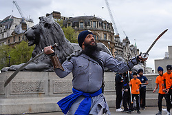 © Licensed to London News Pictures. 27/04/2019. LONDON, UK.  A man performs traditional martial arts during the festival of Vaisakhi in Trafalgar Square, hosted by the Mayor of London.  For Sikhs and Punjabis, the festival celebrates the spring harvest and commemorates the founding of the Khalsa community over 300 years ago.  Photo credit: Stephen Chung/LNP