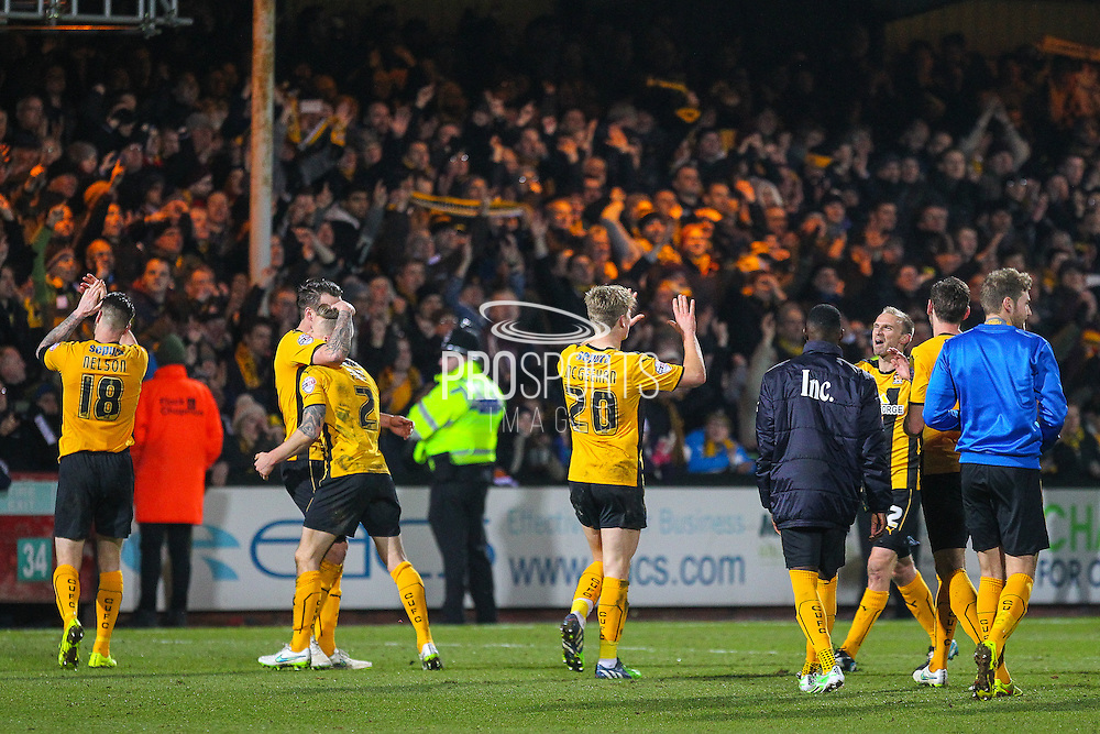 Cambridge United players celebrate their 0-0 draw after the The FA Cup match between Cambridge United and Manchester United at the R Costings Abbey Stadium, Cambridge, England on 23 January 2015. Photo by Phil Duncan.