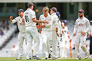 Wicket! Sam Curran of Surrey celebrates taking the wicket of Daniel Bell-Drummond of Kent during the Specsavers County Champ Div 1 match between Surrey County Cricket Club and Kent County Cricket Club at the Kia Oval, Kennington, United Kingdom on 10 July 2019.
