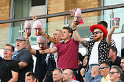 Somerset fans chanting the name of Jack Leach while holding masks during the Vitality T20 Blast South Group match between Somerset County Cricket Club and Middlesex County Cricket Club at the Cooper Associates County Ground, Taunton, United Kingdom on 30 August 2019.
