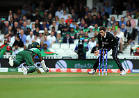 Cricket - 2019 ICC Cricket World Cup - Group Stage: Bangladesh vs. New Zealand<br /> <br /> Mitch Santner of NZ watches Rahim fall as he was  running to the wicket, at Kia Oval.<br /> <br /> COLORSPORT/ANDREW COWIE