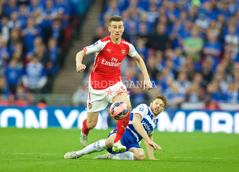 LONDON, ENGLAND - Saturday, April 18, 2015: Arsenal's Laurent Koscielny in action against Reading during the FA Cup Semi-Final match at Wembley Stadium. (Pic by David Rawcliffe/Propaganda)