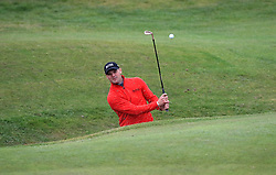 Germany's Martin Kaymer chips out of a bunker on the 2nd during day one of the Betfred British Masters at Hillside Golf Club, Southport.