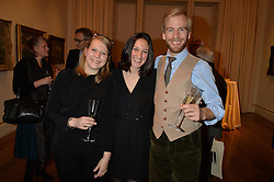 LONDON, ENGLAND 28 NOVEMBER 2016: Left to right, Nerissa Taysom, Shari Kashani, Matthew Reeves at a reception to celebrate the publication of The Sovereign Artist by Christopher Le Brun and Wolf Burchard held at the Royal Academy of Art, Piccadilly, London, England. 28 November 2016.