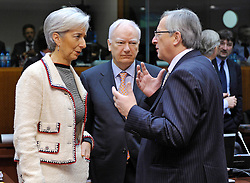 Christine Lagarde, France's finance minister, left, and Philippe Maystadt, president of the European Investment Bank, center, speak with Jean-Claude Juncker, Luxembourg's prime minister, during the meeting of European finance ministers, at EU Council headquarters in Brussels, Belgium, on Tuesday, Feb. 16, 2010. (Photo © Jock Fistick)