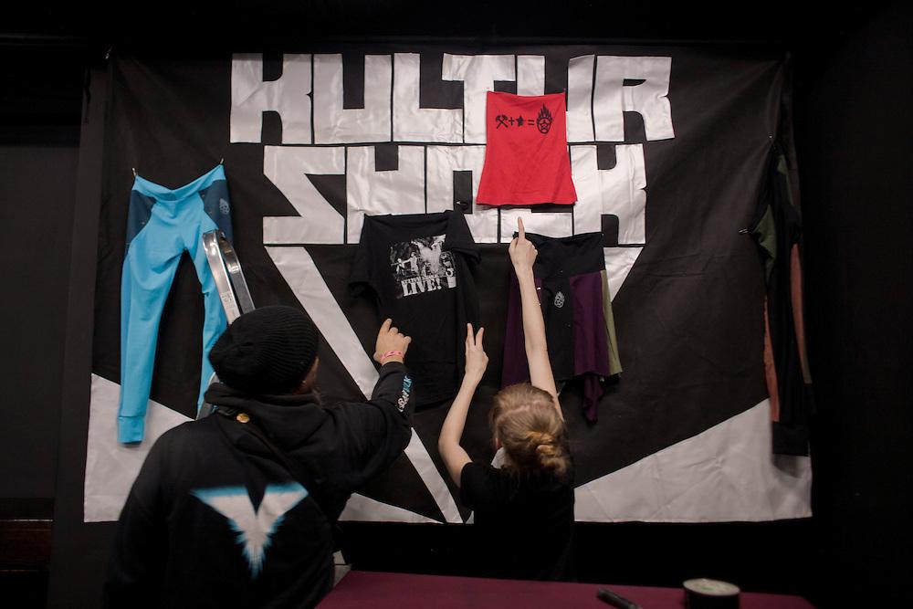 "Srdjan ""Gino"" Jevdjevic, lead singer of Kultur Shock, and Anna Marija Luksic set up the merchandise table at the DFK Club in Banja Luka..."