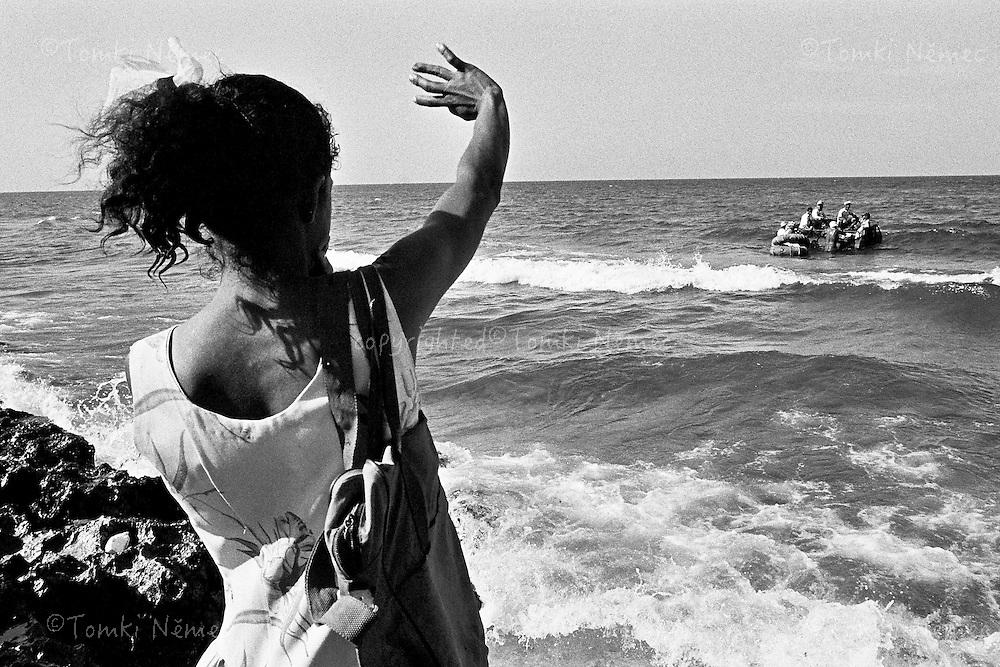 "CUBA/1994                                                                                                                    *EN: Rationing. Emigration. A shortage of basic foodstuffs, medicine, clothing and everyday necessities. Hunger and poverty. Prostitution. Disease. A police state, repression, imprisonment, torture and persecution... Beautiful nature, the ocean, paradise. Tourists. Socialism and permanent revolution. Fidel Castro, Che and the others. This is Cuba. The ""Island of Freedom"".Many Cubans try to escape the ""Island of Freedom"", as government propaganda calls it, on rickety crafts, homemade rafts. Across the powerful sea currents of the Caribbean, and lacking any deeper nautical knowledge, people set out towards Florida, for the USA. On the shore near Havana, sad scenes take place, where often part of the family has to remain in Cuba and part of the family sets out on a dangerous journey, often ending with drowning or as shark bait..*CZ: Pridelovy sytem. Emigrace. Nedostatek zakladnich potravin, leku, obleceni a veci denni potreby. Hlad a  bida. Prostituce. Nemoci. Policejni stat, represe, zavirani, muceni, pronasledovani... Krasna priroda, more, raj na zemi. Turiste. Socialismus a permanentni revoluce. Che, Fidel a ti ostatni. Kuba. ""Ostrov svobody"". Mnoho kubancu se pokousi dostat z Kuby na chatrnych plavidlech, po domacku postavenych vorech. Pres silne morske proudy karibiku a bez hlubsich znalosti moreplavcu se lide vydavaji naslepo k brehum USA. Na pobrezí nedaleko Havany se odehravaji smutne sceny, kdy casto nekolik clenu rodiny musi zustat na Kube a cast rodiny se vydava na nebezpecnou plavbu, nezridka koncici utonutim, nebo jako potrava zraloku."