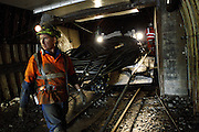 Miners are overlooking operations to bring a new USD 2.5 million excavator drill close to the coal face in order to start extracting again, on Tuesday, June 19, 2007, in Cwmgwrach, Vale of Neath, South Wales. The time is ripe again for an unexpected revival of the coal industry in the Vale of Neath due to the increasing prize and diminishing reserves of oil and gas, the uncertainties of renewable energy sources, and the technological advancement in producing energy from coal while limiting emissions of pollutants, has created the basis for valuable investment opportunities and a possible alternative to the latest energy crisis. Unity Mine, in particular, has started a pioneering effort to revive the coal industry in the area, reopening after more than 8 years with the intent of exploiting the large resources still buried underground. Coal could be then answer to both, access to cheaper and paradoxically greener energy and a better and safer choice than nuclear energy as a major supply for the decades to come. It is estimated that coal reserves in Wales amount to over 250 million tonnes, or the equivalent of at least 50 years of energy supply, while the worldwide total coal could last for over 200 years as a viable resource compared to only a few decades of oil and natural gas.