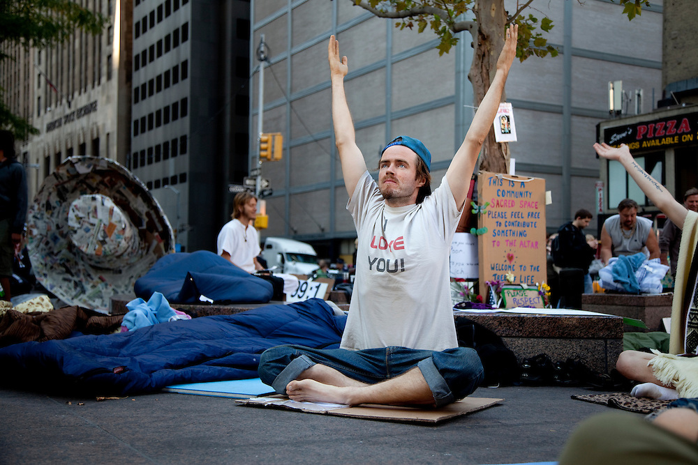 Jaya Garafola stretches with other demonstrators at Occupy Wall Street in Zuccotti Park, New York City, NY on October 10, 2011.