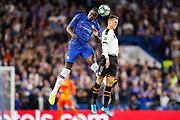 Chelsea defender Kurt Zouma (15) and Valencia CF midfielder Denis Cheryshev (11) clash in the air during the Champions League match between Chelsea and Valencia CF at Stamford Bridge, London, England on 17 September 2019.
