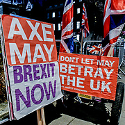 "Banner Axe May ""Vote down May's deal"" at Parliament Yard , on 11 December 2018, London, UK."