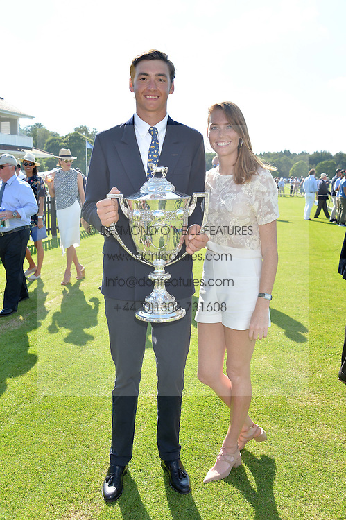 TOMMY BERESFORD young polo player of the year and his sister CAROLINA BERESFORD at The Royal Salute Coronation Cup Polo held at Guards Polo Club,  Smiths Lawn, Windsor Great Park, Egham on 23rd July 2016.