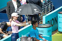 Tennis - 2019 Queen's Club Fever-Tree Championships - Day One, Monday<br /> <br /> Men's Singles, First Round: Fernando VERDASCO (ESP) vs Daniil MEDVEDEV (RUS) [4<br /> <br /> The sun comes out as a ball girl shields Fernando Verdasco (ESP) from the heat of the day on Centre Court.<br />  <br /> COLORSPORT/DANIEL BEARHAM