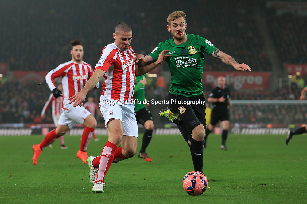 4th January 2015 - FA Cup - 3rd Round - Stoke City v Wrexham - Blaine Hudson of Wrexham battles with Jonathan Walters of Stoke - Photo: Simon Stacpoole / Offside.