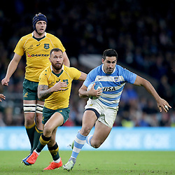 Jeronimo de la Fuente of Argentina goes past Quade Cooper of Australia during the The Rugby Championship match between Argentina and Australia at Twickenham Stadium, Twickenham - 08/10/2016<br />