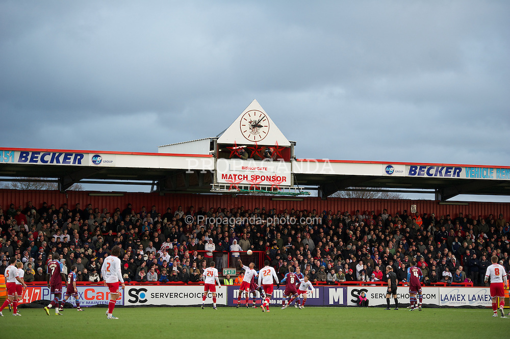 STEVENAGE, ENGLAND - Saturday, December 17, 2011: Television cameramen work under a clock above one of the stands at Stevenage during the Football League One match against Tranmere Rovers at Broadhall Way. (Pic by David Rawcliffe/Propaganda)