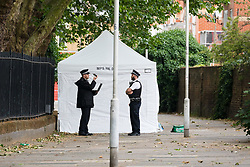 © Licensed to London News Pictures. 17/06/2019. London, UK.  Police officers at the crime scene next to the forensic tent in Whalebone Lane, where police were called by London Ambulance Service at approximately 00:40hrs today, Monday, 17th June to reports of an unresponsive man found collapsed with stab injuries in Whalebone Lane, near to West Ham Lane in Stratford, E15. The man, believed aged in his 40s, was pronounced dead at the scene at 01:01hrs.  Photo credit: Vickie Flores/LNP