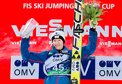 Winner Daniela Iraschko-Stolz of Austria celebrates during flower ceremony after the 11th Women FIS Ski Jumping World Cup competition in Planica replacing Ljubno  on January 25, 2014 at HS95, Planica, Slovenia. Photo by Vid Ponikvar / Sportida