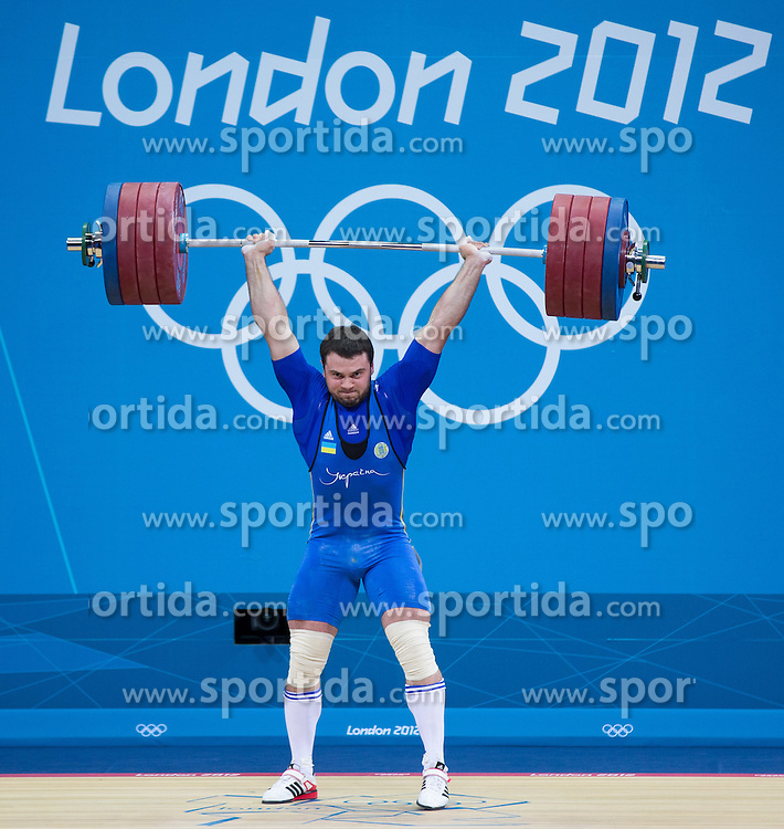 06.08.2012, ExCel, London, GBR, Olympia 2012, Gewichtheben, Herren 105kg, im Bild Oleksiy Torokhtiy (UKR, Gold Medaille) // gold Medal Oleksiy Torokhtiy (UKR) during Weightlifting men's 105kg at the 2012 Summer Olympics at Olympic Stadium, London, United Kingdom on 2012/08/05. EXPA Pictures © 2012, PhotoCredit: EXPA/ Johann Groder