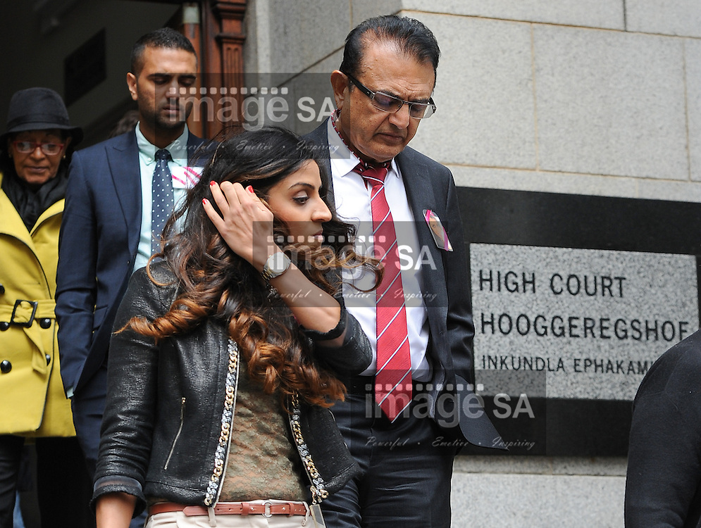 CAPE TOWN, SOUTH AFRICA - Thursday 8 October 2014,   Vinod Hindocha, father of Anni Dewani, leaves court with his niece Nishma Hindocha during Day 3 of the Shrien Dewani trial at the Cape High Court before Judge Jeanette Traverso. Dewani is caused of hiring hit men to murder his wife, Anni. Anni Ninna Dewani (n&eacute;e Hindocha; 12 March 1982 &ndash; 13 November 2010) was a Swedish woman who, while on her honeymoon in South Africa, was kidnapped and then murdered in Gugulethu township near Cape Town on 13 November 2010 (wikipedia).<br /> Photo by Roger Sedres