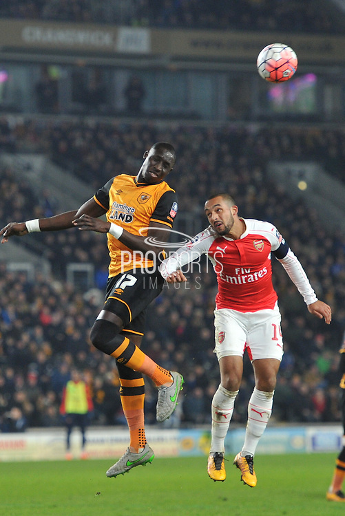 Hull City midfielder Mohammed Diame (17) and Theo Walcott of Arsenal FC (14) during the The FA Cup fifth round match between Hull City and Arsenal at the KC Stadium, Kingston upon Hull, England on 8 March 2016. Photo by Ian Lyall.