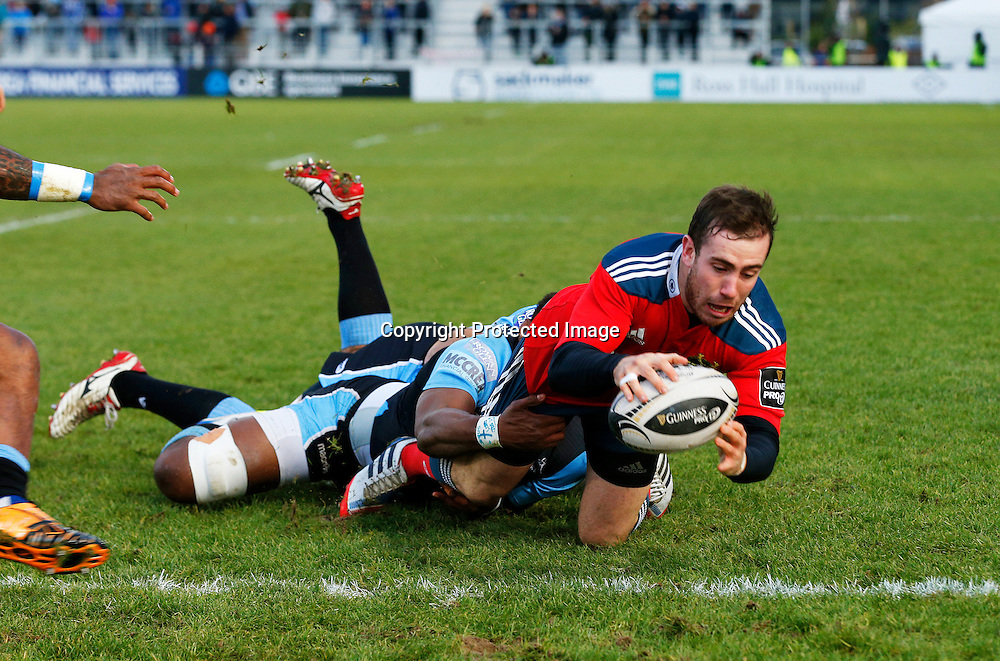 Guinness PRO12, Scotstoun Stadium, Scotland 20/12/2014<br /> Glasgow Warriors vs Munster<br /> Munster's JJ Hanrahan scores try despite Warriors' Josh Strauss and Leone Nakarawa<br /> Mandatory Credit &copy;INPHO/Russell Cheyne