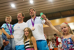 Iztok Cop and Luka Spik during reception of Slovenian Olympic team, on August 5, 2012 in Airport Joze Pucnik, Brnik, Slovenia. (Photo by Vid Ponikvar / Sportida.com)