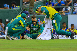 August 5, 2018 - Kandy, Sri Lanka - South African cricket captain Faf Du Plessis receives medical assistance during the 3rd One Day International cricket match between Sri Lanka and South Africa at Pallekele International Cricket Stadium, Pallekele, Kandy , Sri Lanka on Sunday 5 th August 2018  (Credit Image: © Tharaka Basnayaka/NurPhoto via ZUMA Press)