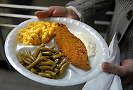 25 MARCH 2011 -- LEMAY, Mo. -- A diner displays a meal comprised of catfish, green beans and macaroni and cheese during the fish fry at St. Andrew Catholic Church in Lemay, Mo. Friday, March 25, 2011. Other options at the fish fry include jack salmon and fried or baked cod. Volunteers served more than 600 meals Friday and ran out of the parish's signature macaroni and cheese, said Karen Wood, one of the parishioners who helps organize the fish fry. Image © copyright 2011 Sid Hastings.