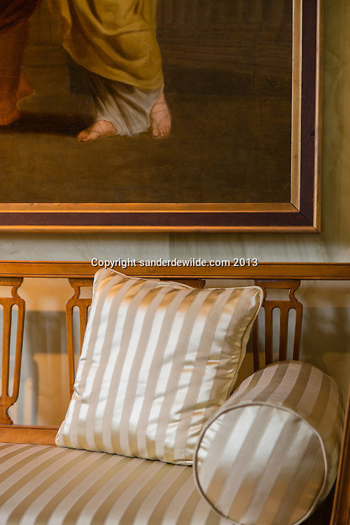 Empire Style cushions on a Empire sofa with part of a painting and a marble painted wall made by Belgian Interior architectThierry THENAERS,photographed on 10th of June 2013 in Castle of Anthée, Belgium. Credit Sander de Wilde for The Wall Street Journal.  Castle