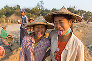 Two young girl road construction workers, smiling, Mrauk U