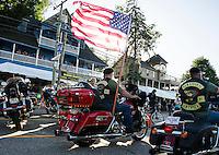The 23rd anniversary POW/MIA Freedom Ride makes it's way down Lakeside Avenue Thursday evening.  (Karen Bobotas/for the Laconia Daily Sun)