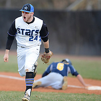 Laura Stoecker/lstoecker@dailyherald.com<br /> St. Charles North's Jack Dennis heads back to the dugout celebrating tagging out Neuqua Valley's Zach Herdman at first in the second inning on Friday, April 11.
