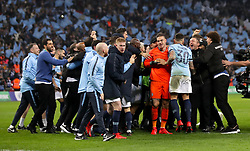 Manchester City goalkeeper Ederson (centre) and team mates celebrate after winning the penalty shoot out of the Carabao Cup Final