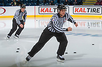 KELOWNA, CANADA - FEBRUARY 17: Linesmen Kevin Crowell and Dustin Minty enter the ice at the start of warm up at the Kelowna Rockets against the Spokane Chiefs on February 17, 2017 at Prospera Place in Kelowna, British Columbia, Canada.  (Photo by Marissa Baecker/Shoot the Breeze)  *** Local Caption ***
