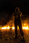 A woman and child reported minor injuries in violent clashes last night in the Asturias region, in Pola de Lena, between miners and police officials, Civil Guards sources were quoted as saying by national state broadcaster. The accidents started at 10 pm local time after protesters set up a road block on the A66 highway, the main road connecting the region to Madrid. Guardia Civil agents intervened after a group of miners took possession of a bus with 31 passengers on board and used it to block traffic and create a barricade using tires set on fire. A battle ensued with police for a few hours and the minor reported injuries after a rocket thrown by a miner hit her window while the woman was injured by glass from a broken window. The road block was removed at 4 am.
