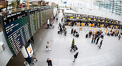 THEMENBILD, Airport Muenchen, Franz Josef Strauß (IATA: MUC, ICAO: EDDM), Der Flughafen Muenchen zählt zu den groessten Drehkreuzen Europas, rund 100 Fluggesellschaften verbinden ihn mit 230 Zielen in 70 Laendern, im Bild Innenansicht Terminal 2, Check-in Schalter mit Passagiere // THEME IMAGE, FEATURE - Airport Munich, Franz Josef Strauss (IATA: MUC, ICAO: EDDM), The airport Munich is one of the largest hubs in Europe, approximately 100 airlines connect it to 230 destinations in 70 countries. picture shows: Interior view of Terminal 2 check-in and passengers, Munich, Germany on 2012/05/06. EXPA Pictures © 2012, PhotoCredit: EXPA/ Juergen Feichter