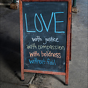 Church blackboard sign &quot;LOVE wifh juctice with compassion with boldness without fail&quot;<br /> <br /> www.ChurchoftheVillage.org