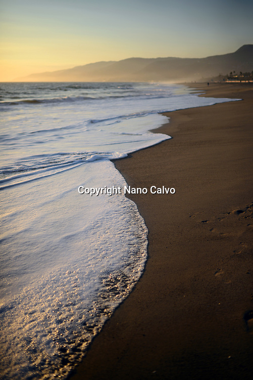 Zuma beach in Malibu at sunset, California.