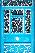CHEFCHAOUEN, MOROCCO - 27th APRIL 2016 -   Blue doorway with decorative metal work in the Chefchaouen Medina - the blue city -  Rif Mountains, Northern Morocco.