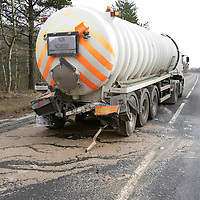 RTC on A9 at Dunkeld....25.02.09<br /> Raw sewage is spread all over the main A9 by Dunkeld Railway Station after two Scottish Water lorries collided at around 9.45am this morning. The picture shows the lorry that spilled the sewage the valve at the rear has been sheared off by the crash<br /> Picture by Graeme Hart<br /> COPYRIGHT: Perthshire Picture Agency.<br /> Tel. 01738 623350 / 07990 594431